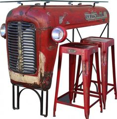 Abandoned vintage tractor that was rescued from an empty field and superbly repurposed into a bar with a glass top. A beautiful way of giving a second and useful long life to this old Massey Ferguson.