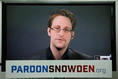 Edward Snowden speaks via video link during a news conference in New York City…