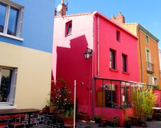 Trentemoult Quarter, Nantes, France.  A dated, picturesque arrondisement to the south-west of the city on the banks of the Loire, normally accessed by boat.  Shamelessly touristic, as implied by the saturated hues along each terrace.  Hence, the few restaurants there are always jam-packed.  It's small, and backs on to an ugly retail park.  But no visit to Nantes is complete without it.  Too pretty?