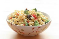 Light and slightly tangy Creamy Pasta Salad, with just enough creamy dressing to coat the noodles and vegetables, this is one heck of an awesome pasta salad