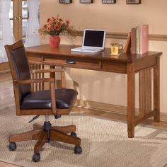 Signature Design by Ashley Cross Island Large Leg Desk - The Signature Design By Ashley Cross Island Large Leg Desk is a modular design with laptop drawer, internet port, and electrical outlet built ...