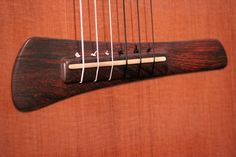 Modern nylon string guitar bridge