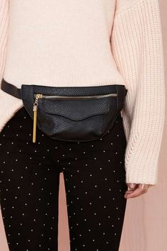 Work that reptilian vibe into your look with this sassy-as-hell fanny pack! It has interior and exterior pockets, gold hardware, and a faux crocodile-skin shell.