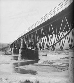 Tordera Bridge, Tordera, Barcelona, Catalonia, Spain, Europe  Completed in: 1939 Structural Type: Lenticular bridge Materials:      Truss: Steel      Deck slab: Reinforced concrete  Total length: 145.8 m; Span lengths: 45.70 m - 54.85 m - 45.70 m; Deck width: 8.55 m*  Designer: Eduardo Torroja y Miret Engineer: G. Andreu Engineer: Cesar Villalba Granda *During 1993 - 1994 The bridge was rehabilitated and widened to 11.5 m.709)