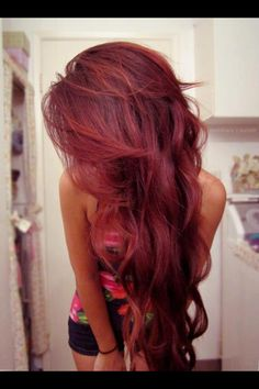 Maroon colored hair, wavy.