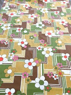 """VINTAGE 1970 CANNON ROYAL FAMILY 'Great Day' pattern bed sheets. """"All aglow with flowers and geometries -a bold tricolor print that's fun and gay. Stays wrinkle-free on polyester and cotton blend percale. Available in Celestial blue, old gold, and fudge."""""""