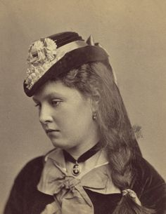 A captivating close up portrait of a beautifully attired Victorian woman.