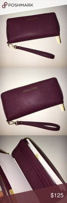Michael kors wallet New! Still has tags. Color:PLUM. Style: TRAVEL CONTINENTAL. Willing to consider reasonable offers! No lowballing please. No trades. Michael Kors Bags Wallets