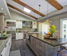 Love the vertical glass tile backsplash, distressed barn wood, and cold rolled steel counters