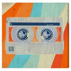 Equally at home in an artful collage or on its own as an eye-catching focal point, this hand-stretched canvas print showcases a Pop Art-inspired cassette tape motif. Made in the USA.
