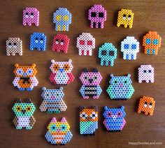 Perler beads were one of my favorite things as a kid.  Might have to get some and make these little owls and pac man ghosties!