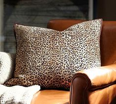 Cheetah Printed Pillow Cover #potterybarn, 4 of these would be a great start for the sofas...goes with anything...buy an insert one size bigger for fullness