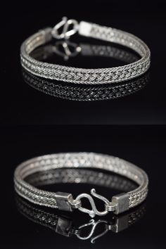 """This stunning braided/ woven bracelet is made of solid sterling silver. The piece has an S hook closure. The end of the bracelet is hallmarked 925. Measures Aprox 8"""" long 3/8"""" wide Weight Aprox 19.7 Grams UNISEX"""