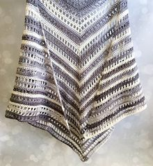 With just two skeins of Lion Brand Ice Cream yarn and this free pattern you can crochet this beautiful, summer weight shawl! Click the link below to get the free pattern on my blog.