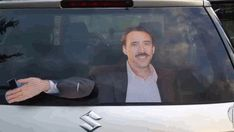 Guy Turns Back Window Wiper Into A Nicolas Cage Who Can't Stop Waving At You