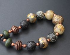 Lampwork beads with gold foil, ceramic bead, agate, copper, lava stone.