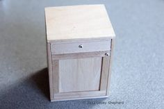 Dollhouse kitchen base cabinet with shaker style door.
