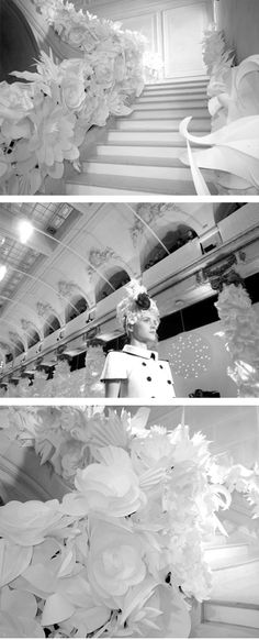 Cut paper art work of 7,000 handmade white paper flowers that lined the runway of Chanel's Spring/Summer show in Paris, 2009