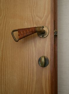 Alvar Aalto Door Handle at the Maison Louis Carré. For Alvar Aalto, grasping a door handle is akin to shaking hands with a building. Leather-wrapped door handles were one of Aalto's methods of offering a welcome touch.