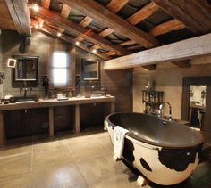 Minus the cow print on the tub, love this luxurious industrial bathroom