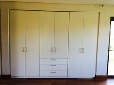 Duco cupboards with shadow lines.