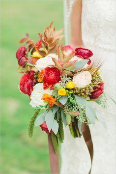 loose sunset colored bouquet #bouquet #weddingflorals #weddingchicks http://www.weddingchicks.com/2014/02/25/rustic-ritzy-ranch-wedding/