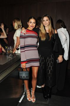 Olivia Culpo wearing the Mathilde red multi sweater dress. Pair it with a long sleeved undershirt like the Shack shirt or the Artist shirt for a layered look.