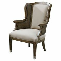 "Bring stately appeal to your living room or den with this handsome arm chair, showcasing a sun-washed pecan finish and nailhead trim.   Product: ChairConstruction Material: Poplar wood, cane, metal and faux leatherColor: Sun-washed pecan and beigeFeatures:  Nailhead trimTapered legsFlared back legsCane accents Dimensions: 40.25"" H x 27.5"" W x 31.5"" D"