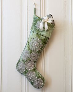 Made from soft velvet and featuring a gorgeous sage color with a cascade of sparkling snowflakes, the Sage Velvet Snowflake Stocking provides a beautiful setting for the special gifts you've prepared for Christmas morning.