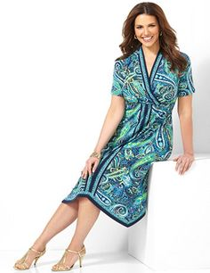 Shoreline Dress: Enhance your silhouette with this lovely, must-try dress. Bright paisleys swirl along the silky, stretch fabric, while a vertical border print offers a slimming look down the front. Rhinestones shine at the surplice V-neckline. Complete with short sleeves. catherines.com #catherines #plussizestyle #springstyle #plussizedress