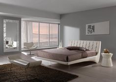 MAYA - Upholstered bed bedframe version - Covered with faux leather art. Soft col. 15 white  Removable cover - Sizes cm. W 173 D 225 H 93 Paired with bedside table mod. Samoa - bench mod. Kristell - chair mod. Onda and  mirror mod. Milù #interiordesign #bedroom #elegance #custom #luxury #beds #fabrics #decor #tufted #handmade
