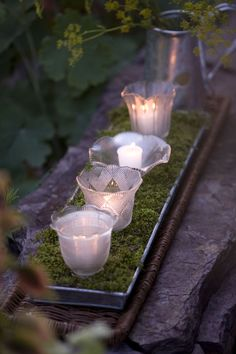 Votives on moss in a metal plant tray. Use mixed glass containers of the same size to hold the candles - jars, glasses, . These are globes off of light fixtures. Candle Lanterns, Votive Candles, Citronella Candles, Ideas Candles, Yankee Candles, Glass Votive, Floating Candles, Glass Globe, Lampshades