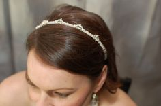 """Crystal Tiara, $40.00 Simpler and more reasonable. Would depend on hair, I guess. Hadn't gotten farther on that front than """"clean, maybe blue."""""""