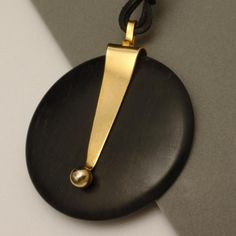 Couture necklace in dark wood, with gold-plated extended bail which supports the disc. This necklace dates to the It is hallmarked D Wooden Jewelry, Custom Jewelry, Vintage Jewelry, Jewelry Drawing, Earring Cards, Christmas Earrings, Jewellery Display, Leather Cord, Jewelry Collection