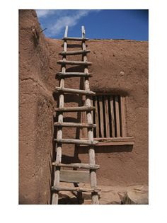 A handmade wooden ladder rests against an adobe structure:     This is rather like the ones that Landi and Haku would make for themselves.