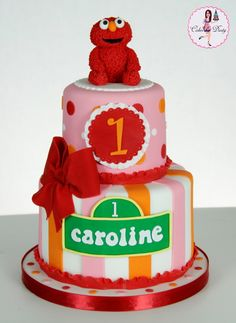 Elmo cake....simplify, no bow, smaller number, but I like the little Elmo sitting on top...