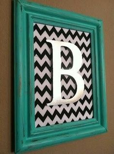 Chrome letter affixed to chevron fabric backed painted rustic frame. Shabby Chic!