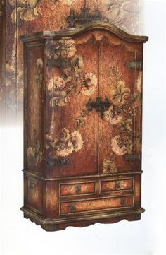 Extravagant Red Armoire. h1Extravagant Red Armoire_h1This highly decorative armoire has large floral designs hand-painted all over the double doors, sides and 3 drawers, plus antique hasps and door hardware. Hand-crafted in Peru. Allow 4-6 weeks .. . See More Armoires at http://www.ourgreatshop.com/Armoires-C1067.aspx