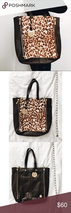 Vince Cameron shoulder bag with leopard print Authentic Vince Camuto shoulder bag with leopard print and logo pendant chain. Absolutely stunning accessory to spice of any outfit! Measurements shown in image. Vince Camuto Bags Shoulder Bags