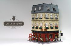 Take in a good brew and a good book at The Queen's Brick. The three story modular, built by Filip Olin, contains a pub on the first level and a private cub and library on the upper floors. Th…