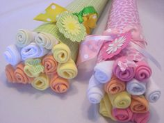 Adorable bouquet of baby washcloths made by YummyWearDiaperCakes.