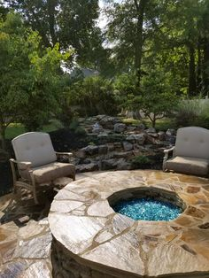 A stone patio & gas fire pit accent this backyard paradise. Patio Gas, Stone Masonry, Backyard Paradise, Outdoor Kitchens, Fireplaces, Pond, Nursery, Outdoor Decor, Home Decor