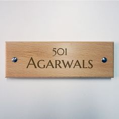 Simple yet elegant wooden name-plates for your apartment. Available for delivery across India.
