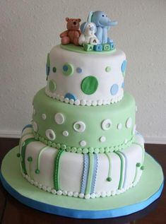 love the lines and dots on this baby shower cake.