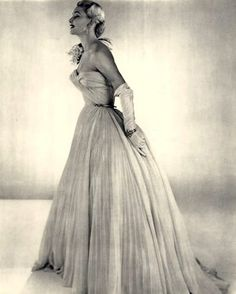 Evening gown by Pierre Balmain and jewelry by Boucheron, French, 1952.