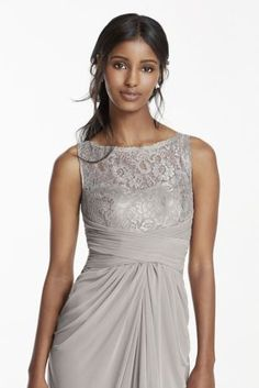 Simply elegant in design, your bridal party will look exceptional in this long mesh dress!  Sleeveless bodice features ultra-feminine corded lace illusion sweetheart neckline and illusion v back.  Long mesh skirt with ruched waist and front leg slit.  Fully lined. Back zip. Lace-52% Nylon/48% Rayon. Mesh-100% Polyester. Dry clean only.  To protect your dress, try our Non Woven Garment Bag.