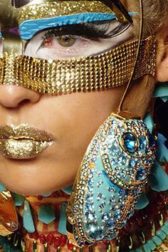 This post, with the ancient Egypt theme, segues nicely from my previous one. Apparently John Galliano took a hot air balloon tour of Egypt when was researching his Spring 2004 haute couture collection for Christian Dior. It's merger of references. John Galliano, Galliano Dior, Christian Dior, Pat Mcgrath Makeup, Egyptian Fashion, Egyptian Hair, Egyptian Beauty, Egyptian Scarab, Egyptian Queen