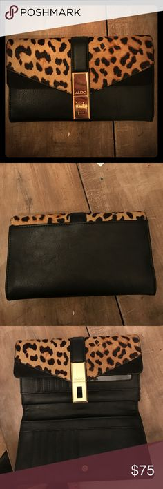 Aldo leopard wallet/clutch Faux fur leopard detail with gold hardware and black leather. EUC only used a couple times and great size with lots of space! Totally chic and perfect for any season! Aldo Bags