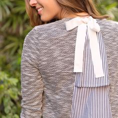 There's so much amazing going on with this back-detail top, simply pair it with jeans. Denim & done. (Nawny Tiered Back Top)