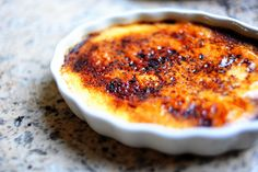 Creme Brulee (Pioneer Woman)  4 cups Heavy Cream  1 whole Vanilla Bean OR 1 Tablespoon Vanilla Extract OR 1 Tablespoon Vanilla Paste  10 whole Egg Yolks  3/4 cups Sugar  6 Tablespoons Superfine (Baker's) Sugar